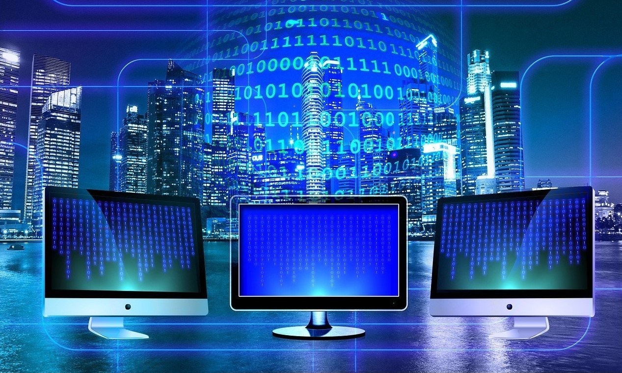 Image of binary code and PC monitors
